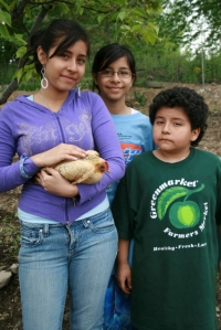 Rodriquez kids with Maybell the chicken
